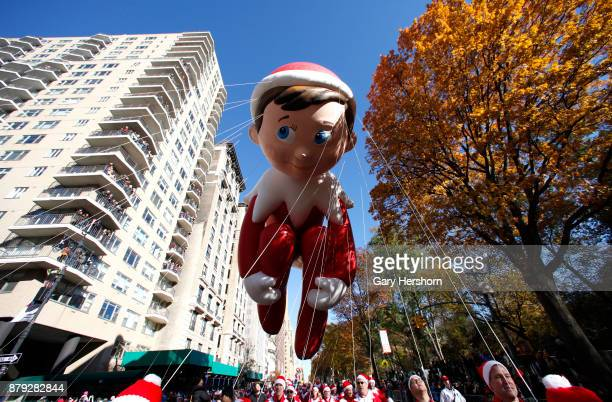 The Elf on a Shelf balloon floats down Central Park West during the annual Thanksgiving Day Parade on November 23 2017 in New York City