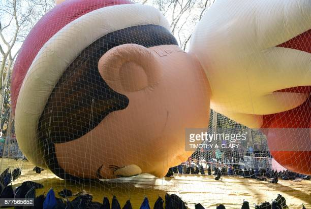 The Elf on the Shelf ballon lays on the ground during the Macy's Parade balloon inflation November 22 2017 The annual Macy's Thanksgiving Day Parade...