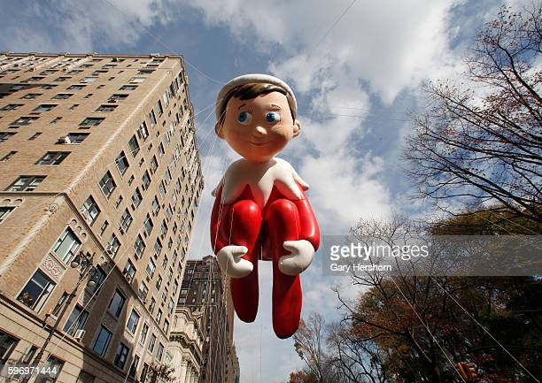 The Elf on the Shelf balloon floats down Central Park West in the Macy's Thanksgiving Day Parade in New York November 26 2015
