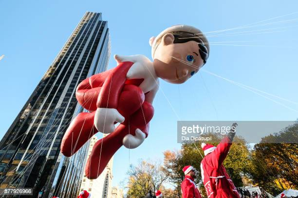 The Elf on the Shelf balloon floats in Columbus Circle during the 91st Annual Macy's Thanksgiving Day Parade on November 23 2017 in New York City