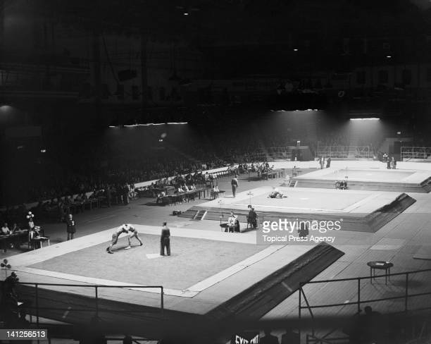 The eliminating rounds of the Greco-Roman Wrestling events taking place at Empress Hall, Earl's Court, during the London Olympics, 4th August 1948.
