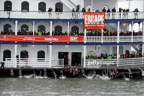 The elite athletes dive off of the San Francisco Belle for the start of the 2014 Escape from Alcatraz Triathlon on June 1 2014 in San Francisco...
