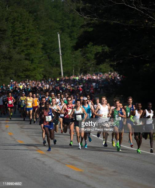 The elite men lead the pack of Beach to Beacon runners at the start of the race on Saturday, August 3, 2019. Alex Korio, front left, broke ahead...