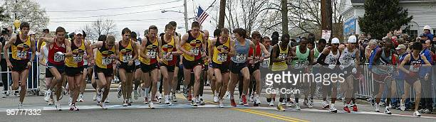 The elite men's marathon runners begin their twenty six miles and three hundred eighty five yards at the start of the 110th running of the Boston...