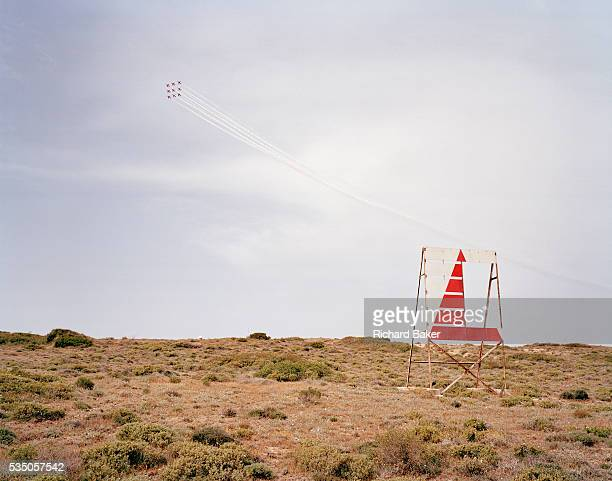 The elite 'Red Arrows' Britain's prestigious Royal Air Force aerobatic team fly over an area known as the Cliffs on the Akrotiri peninsular of...