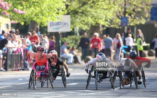 The Elite wheelchair runners take part in the 2018 London Marathon on its way through Greenwich in London United Kingdom on April 22 2018