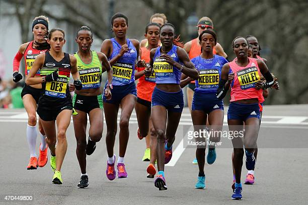 The Elite Women led by Desiree Linden of the United States Caroline Rotich of Kenya Joyce Chepkirui of Kenya and Caroline Kilel of Kenya run during...