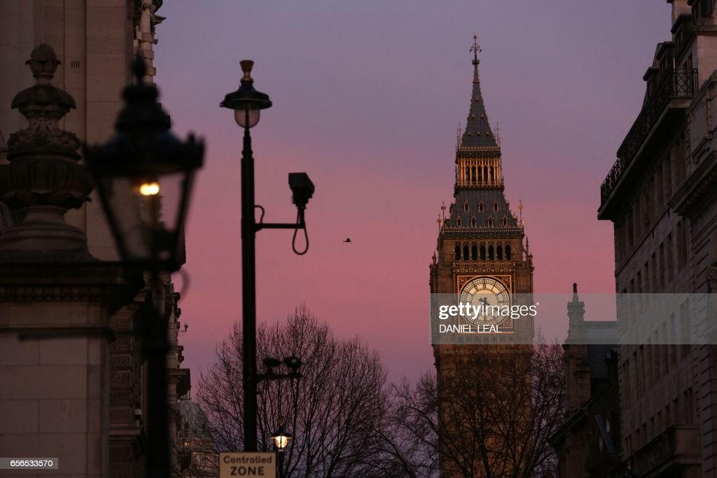 TOPSHOT - The Elizabeth Tower at the Houses of Parliament, are pictured in Westminster, central London on March 22, 2017, in the aftermath of a terror incident. At least three people were killed and 20 injured in a 'terrorist' attack in the heart of London Wednesday when a man mowed down pedestrians on a bridge, then stabbed a police officer outside parliament before being shot dead. Police guarding the iconic House of Commons building shot the man but several people were left with 'catastrophic' injuries on Westminster Bridge, a busy traffic junction popular with tourists with views of Big Ben. /