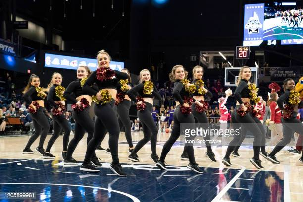The Elon Phoenix Dance Team performs during the second half of the Colonial Athletic Association Men's Basketball Championship Tournament between the...
