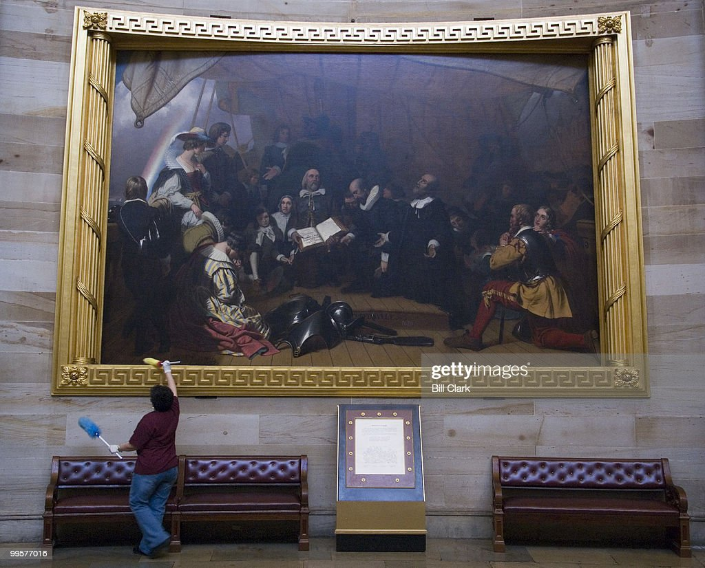 The 'Embarkation of the Pilgrims' painting in the Rotunda gets dusted by an Architect of the Capitol worker on Monday afternoon, May 7, 2007.