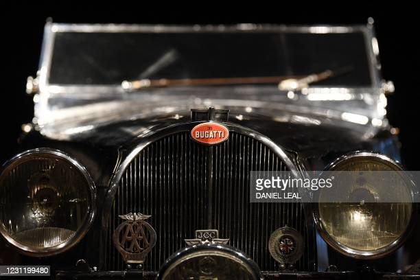 The emblem and front grill of a 1937 Bugatti Type 57S, nicknamed 'Dulcie' due to its registration number 'DUL 351', is pictured at Bonhams in central...