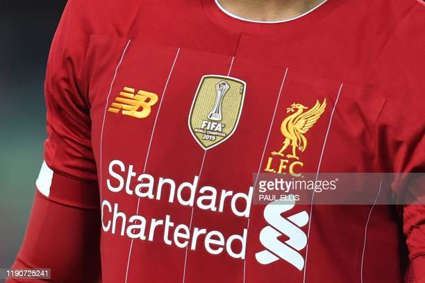 The emblem commemorating Liverpool's FIFA Club World Cup victory is seen on the shirt of Liverpool's English defender Joe Gomez during the English...