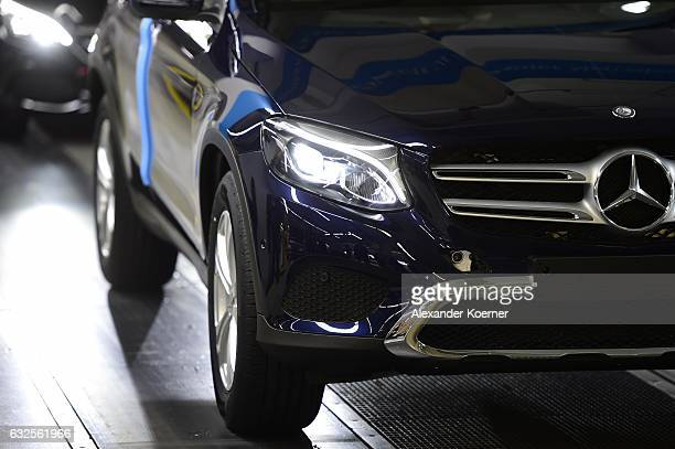 The emblem of a MercedesBenz of CClass car is pictured on the assembly line of MercedesBenz on January 24 2017 in Bremen Germany Daimler AG which...