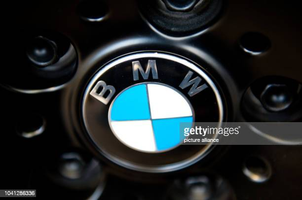 The emblem of automobile company BMW is pictured prior to a press briefing on annual results in Munich Germany 19 March 2013 After the best financial...