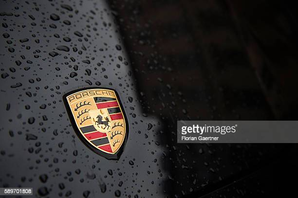 The emblem of Porsche is captured on a wet engine cowling on August 04 2016 in Berlin Germany