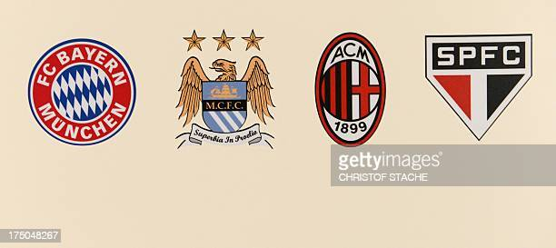The emblems of the football clubs FC Bayern Munich Manchester City AC Milan and FC Sao Paulo are seen at a press conference on the football Audi Cup...