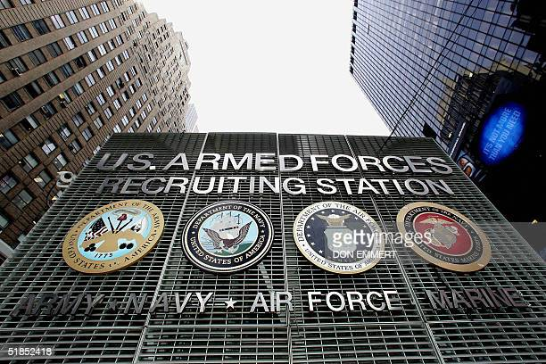 The emblems of the four branches of the US armed forces are seen on the military recruiting station in New York's Times Square 09 December 2004....