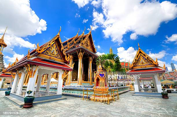 the emerald buddha temple in grand palace - bangkok stock photos and pictures