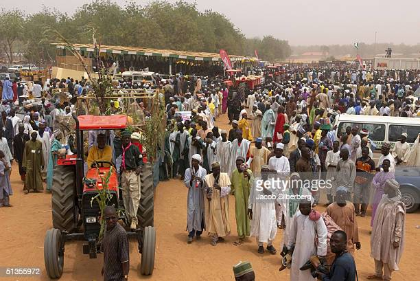 The Emir of Argungu lead a procession of tractors through the crowd at the Argungu Fishing Festival on March 18 2004 in Argungu Nigeria The Argungu...