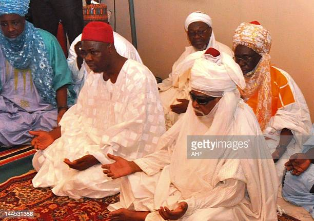 The emir of Kano Ado Bayero and the secretary to the Kano state government Rabiu Suleiman Bichi who represents governor Rabiu Musa Kwankwaso offer...