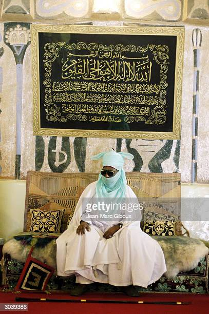 The Emir of Kano Alhaji Dr Ado Bayero sits in his palace in the old city of Kano November 12 2002 in northern Nigeria The Emir of Kano is the...