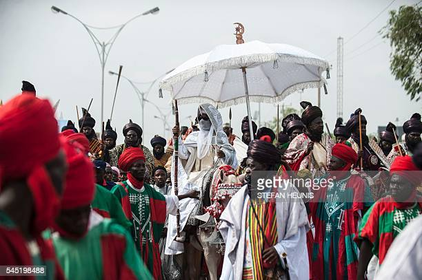 TOPSHOT The Emir of Kano Muhammadu Sanusi II and his procession ride through the streets of Kano during the Durbar Festival in Kano northern Nigeria...