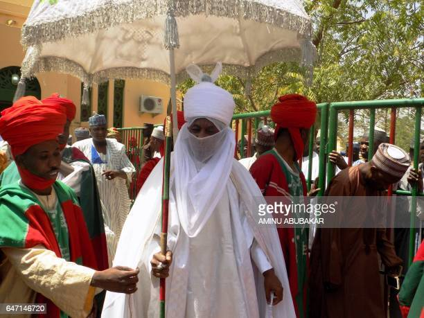 The Emir of Kano Muhammadu Sanusi II arrives to attend the mass wedding of 1520 couples at the city's central mosque on February 26 2017 The Emir of...