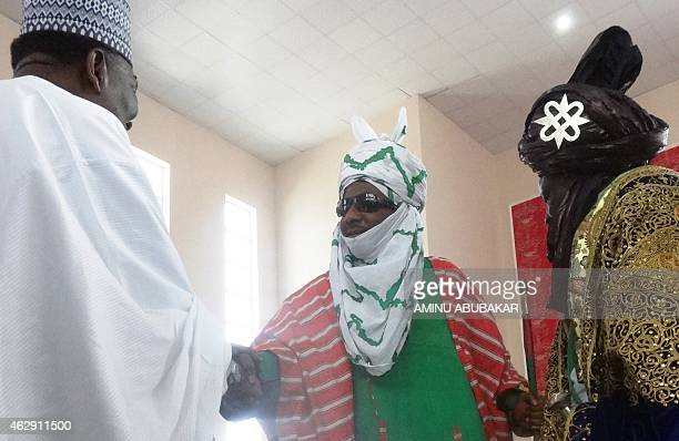 The emir of Kano Muhammadu Sanusi II shakes hands with Nigeria's former military ruler Yakubu Gowon during his coronation as the 57th emir of the...