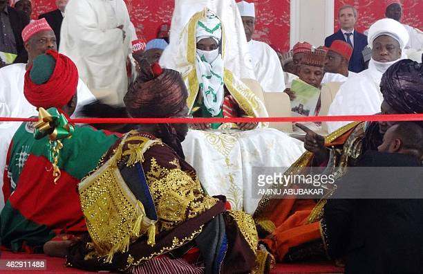 The emir of Kano Muhammadu Sanusi II sits in front of royal guards during his coronation as the 57th emir of the ancient Kano emirate on February 7...
