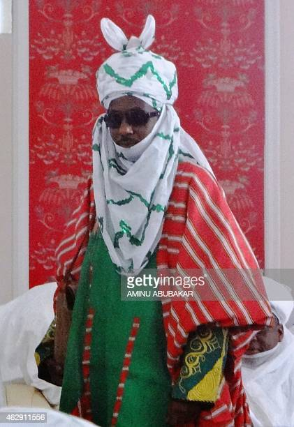The emir of Kano Muhammadu Sanusi II stands during his coronation as the 57th emir of the ancient Kano emirate on February 7 2015 at the newly built...