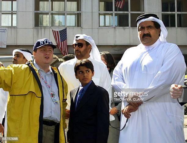 The Emir of Qatar Sheik Hamad bin Khalifa Thani and his son nineyearold son Khalifa bin Hamad AlThani are accompanied by First Deputy Director of the...