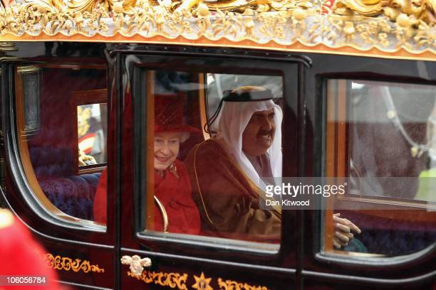 The Emir of Qatar Sheikh Hamad bin Khalifa al Thani and Queen Elizabeth II make their way to Windsor Castle on October 26 2010 in Windsor England The...