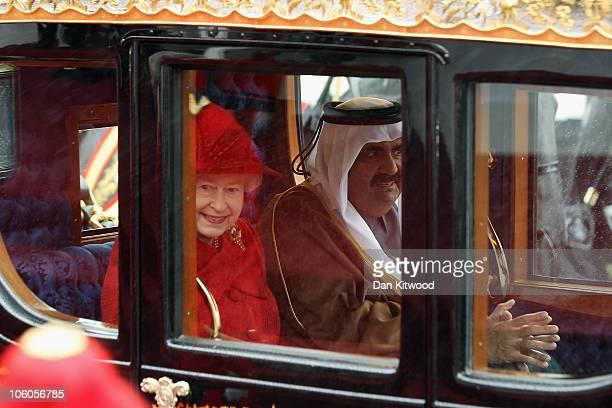 The Emir of Qatar Sheikh Hamad bin Khalifa al Thani and Queen Elizabeth II make their way to Windsor Castle on October 26 2010 in Windsor England The...