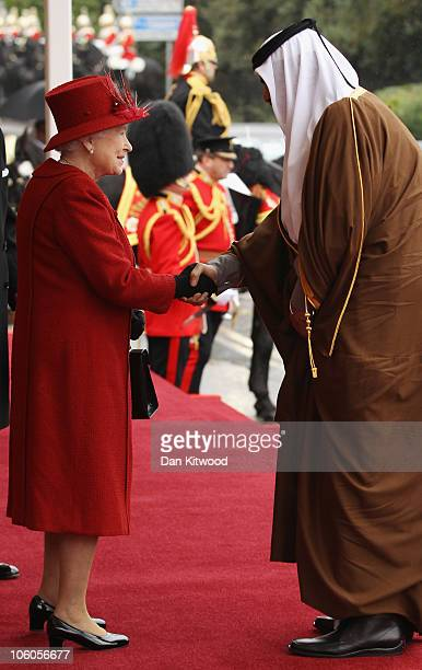 The Emir of Qatar Sheikh Hamad bin Khalifa al Thani is greeted by Queen Elizabeth II on October 26 2010 in Windsor England The Sheikh is on a two day...