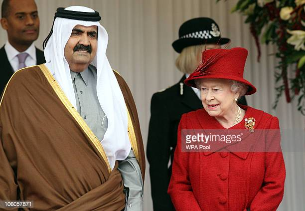 The Emir of Qatar Sheikh Hamad bin Khalifa al Thani is greeted by Queen Elizabeth II on October 26 2010 in Windsor England The Sheikh is on a two day...