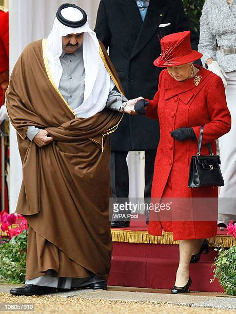 The Emir of Qatar Sheikh Hamad bin Khalifa al Thani is greeted by Queen Elizabeth II and Prince Philip Duke of Edinburgh on October 26 2010 in...