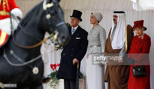 The Emir of Qatar Sheikh Hamad bin Khalifa al Thani is greeted by Queen Elizabeth II and Prince Philip Duke of Edinburgh on October 26 2010 in...