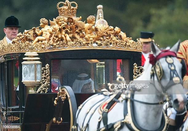 The Emir of Qatar Sheikh Hamad bin Khalifa al Thani travels in a horsedrawn carriage with Queen Elizabeth II on October 26 2010 in Windsor England...