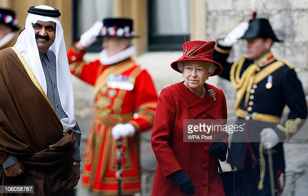The Emir of Qatar Sheikh Hamad bin Khalifa al Thani walks with Queen Elizabeth II in the grounds of Windsor Castle on October 26 2010 in Windsor...