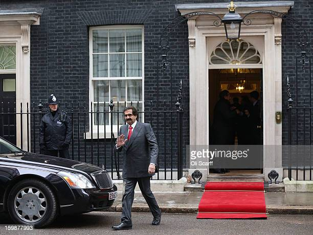 The Emir of Qatar Sheikh Hamad bin Khalifa Al Thani waves as he leaves Number 10 Downing Street after meeting his with British Prime Minister David...