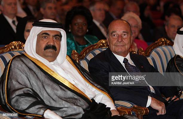 The Emir of Qatar Sheikh Hamad bin Khalifa alThani and former French president Jacques Chirac attend at the Doha Forum on Democracy Development and...