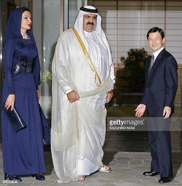 The Emir of Qatar Sheikh Hamad bin Khalifa alThani and his wife Sheikha Mozah are welcomed by Japanese Crown Prince Naruhito upon their arrival at...