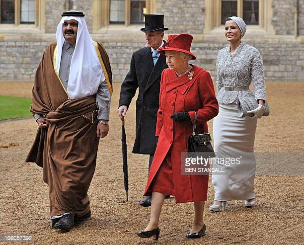 The Emir of Qatar Sheikh Hamad bin Khalifa alThani and his wife Sheikha Mozah walk with Britain's Queen Elizabeth II and her husband Prince Philip at...