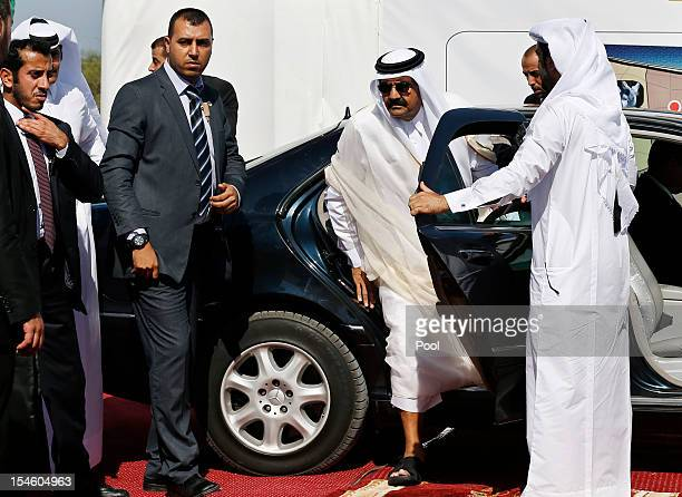 The Emir of Qatar Sheikh Hamad bin Khalifa alThani arrives to a cornerstonelaying ceremony for Hamad a new residential neighbourhood October 23 2012...