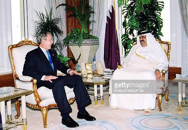 The emir of Qatar Sheikh Hamad bin Khalifa alThani meets with US President George W Bush at his palace in Doha 05 June 2003 Bush showered praise on...