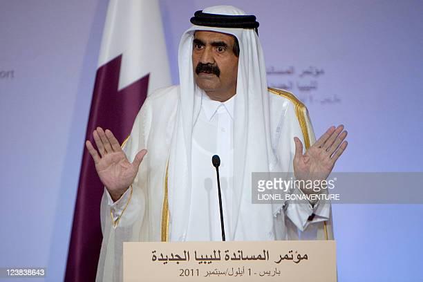 The emir of Qatar, Sheikh Hamad bin Khalifa al-Thani speaks during a press conference following a summit on the post-Kadhafi held at the Elysee...