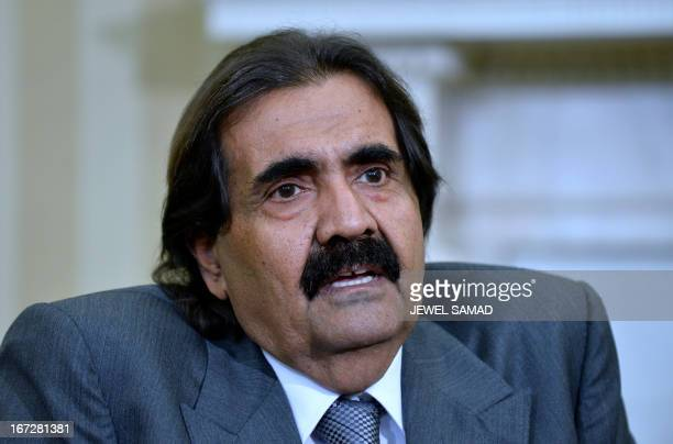 The Emir of Qatar Sheikh Hamad bin Khalifa alThani speaks to the media following his meeting with US President Barack Obama in the Oval Office of the...