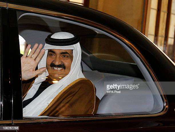 The Emir of Qatar Sheikh Hamad bin Khalifa AlThani waves goodbye to Queen Elizabeth II and Prince Philip the Duke of Edinburgh at Windsor Castle on...