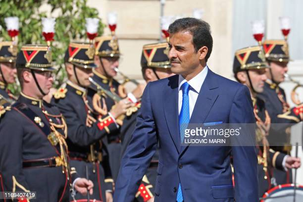The emir of Qatar Sheikh Tamim bin Hamad al-Thani arrives for talks with French president Emmanuel Macron at the Elysee in Paris on September 19,...