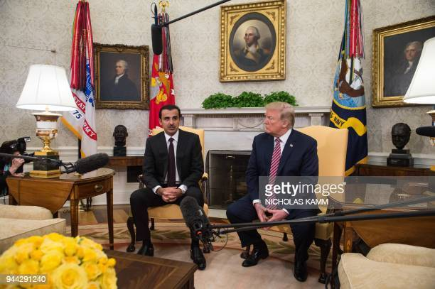 The Emir of Qatar Sheikh Tamim bin Hamad alThani speaks to the press with US President Donald Trump in the Oval Office at the White House in...